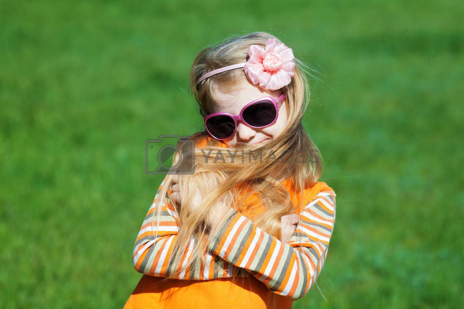 shy fashion girl with long hair outdoors