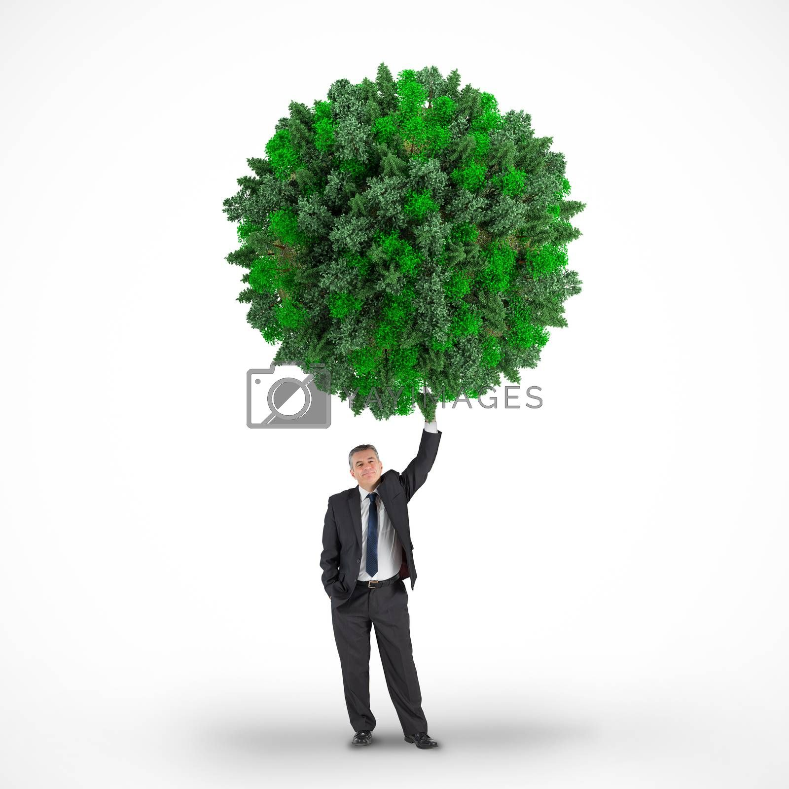 Composite image of businessman holding green sphere against white background with vignette