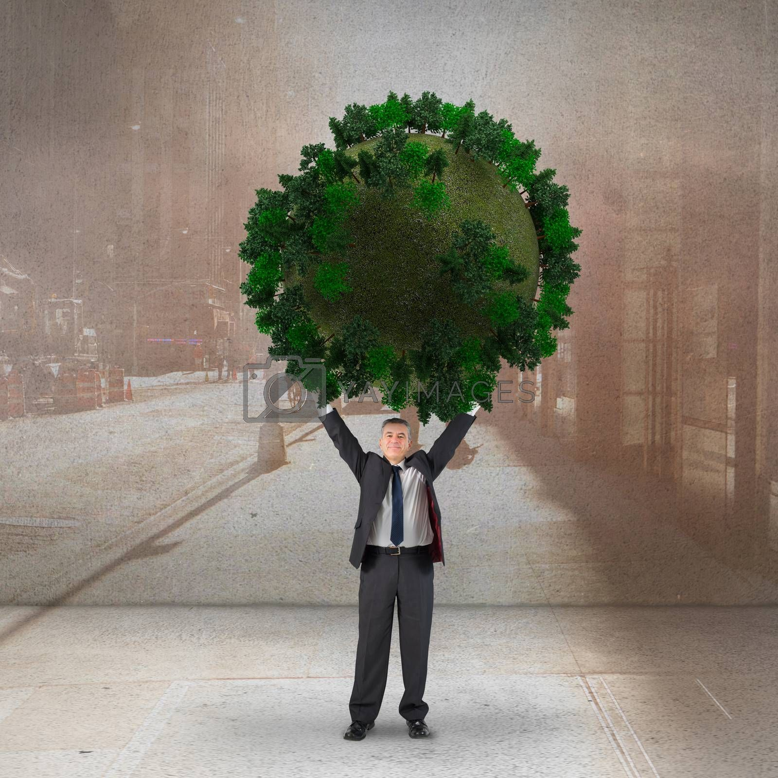 Composite image of businessman holding green sphere by Wavebreakmedia