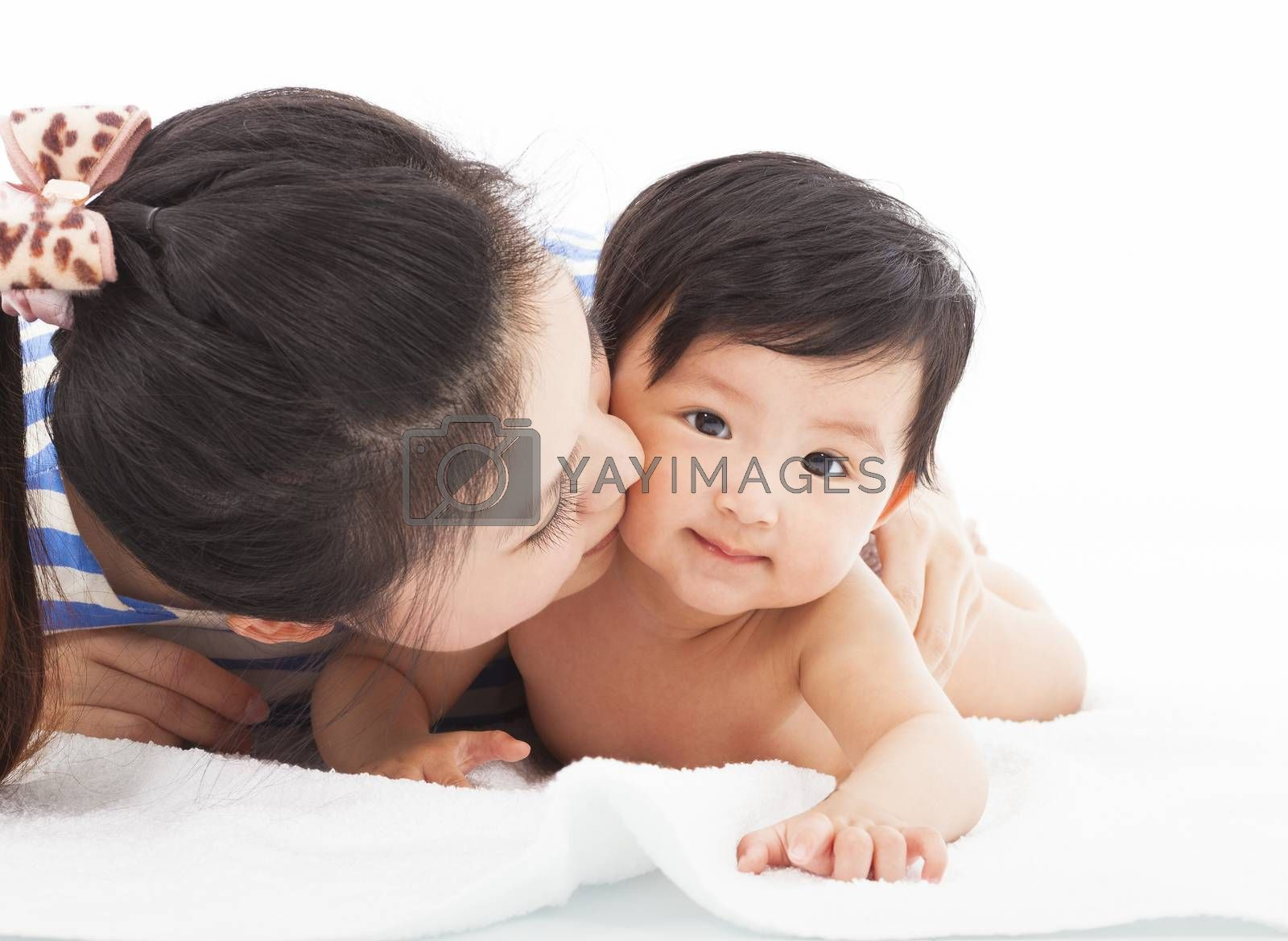 Royalty free image of Happy mother kissing  smiling child baby  by tomwang