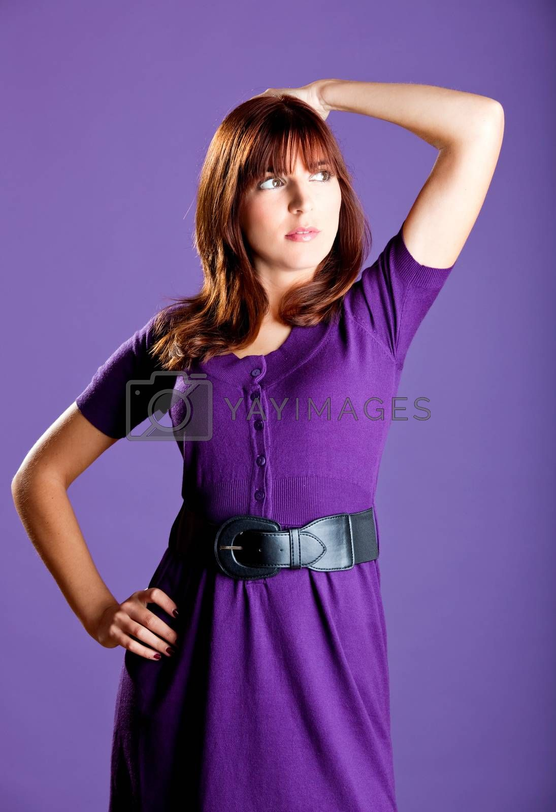 Portrait of a beautiful fashion woman over a violet background