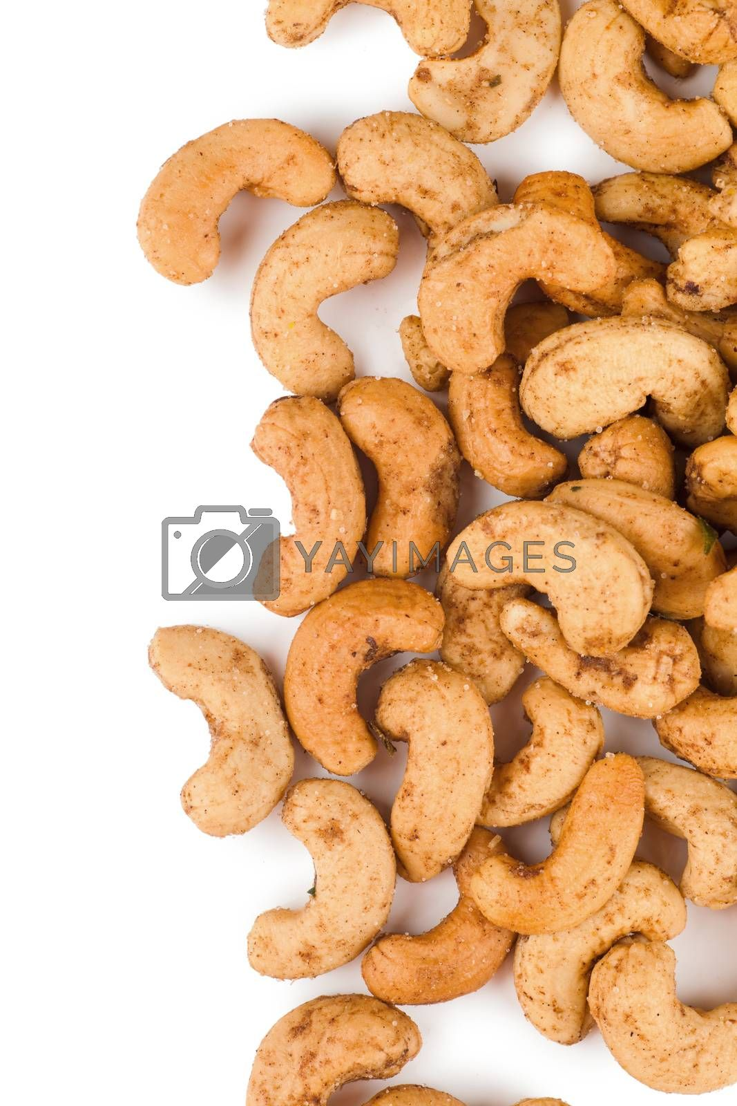 Closeup view of heap of cashew nuts over white background