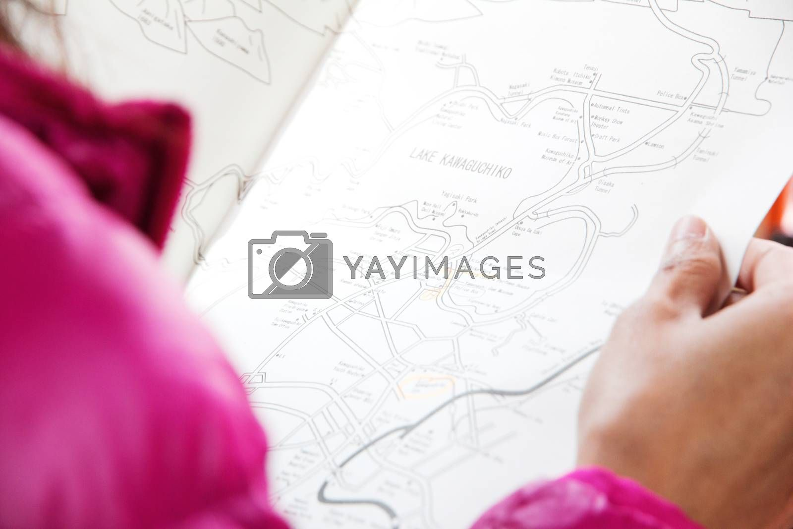 girl looking at map travel in japan
