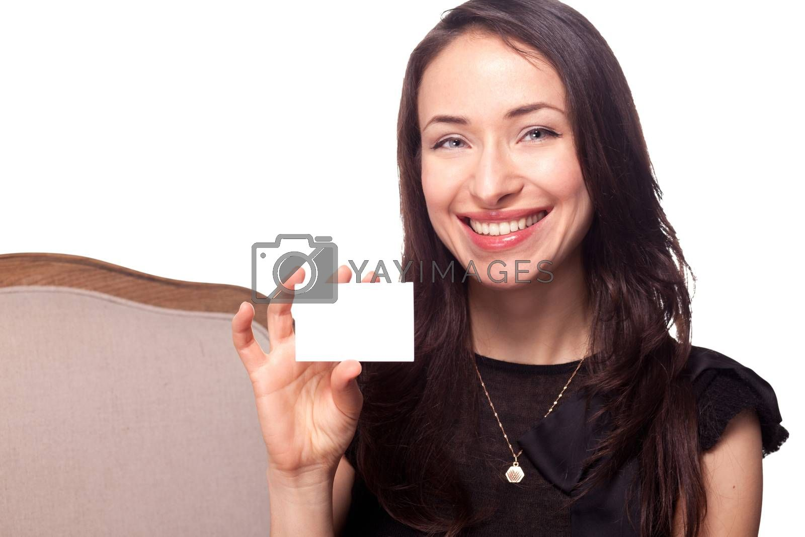 Girl holding blank business card template and smiling isolated on white