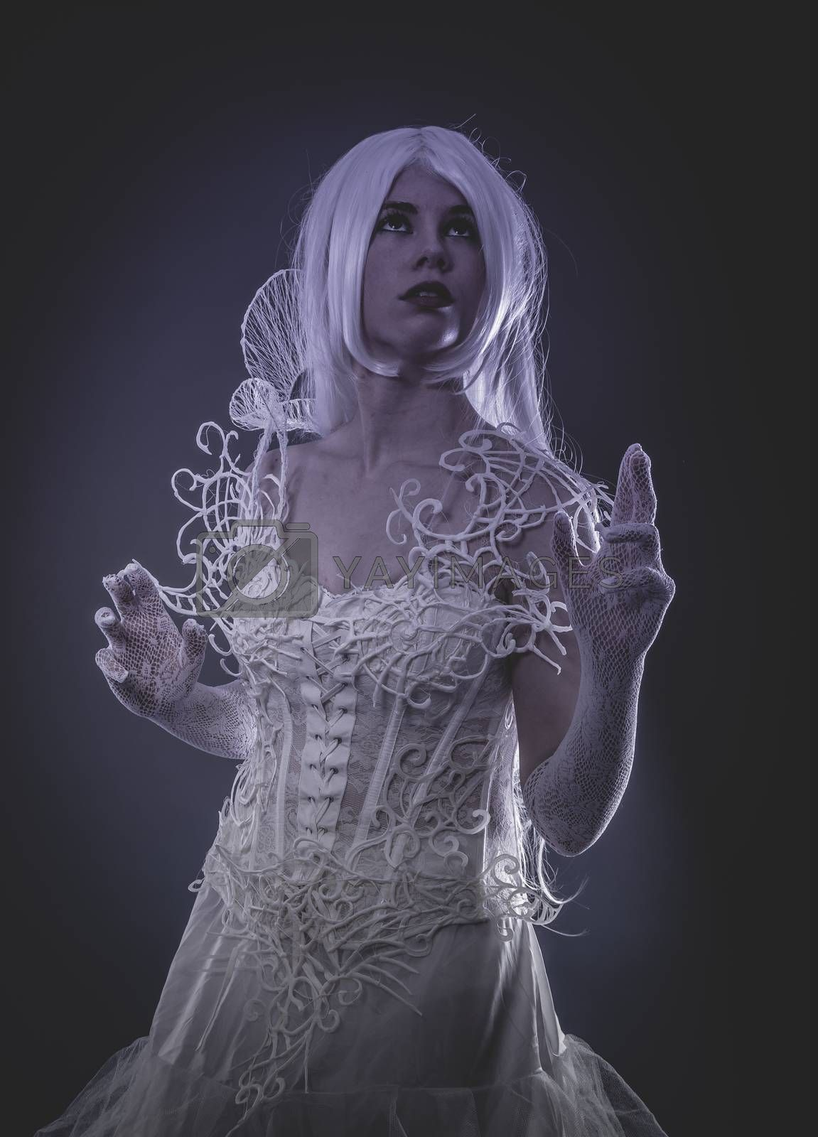 Sensual lady in white corset, long hair, handmade dress