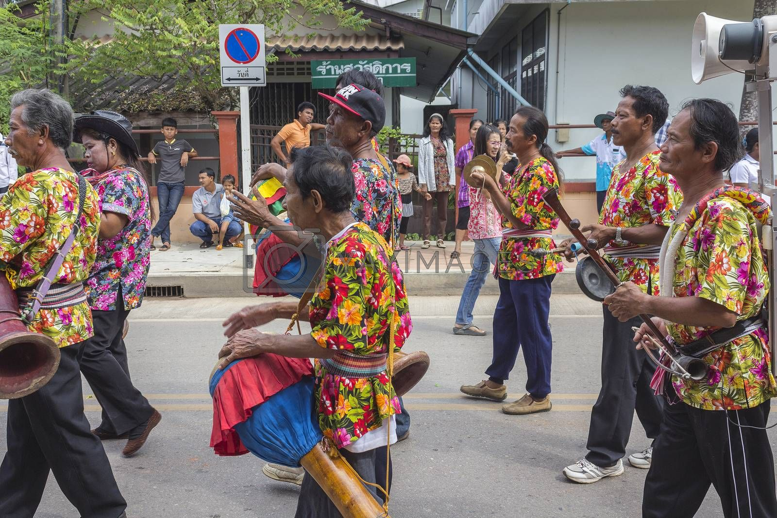 """THAILAND - OCTOBER 20: Unidentified people participated in """"Ngan Chak Pra"""", a traditional buddhist festival on October 20, 2013 in Chaiya,Suratthani, Thailand."""