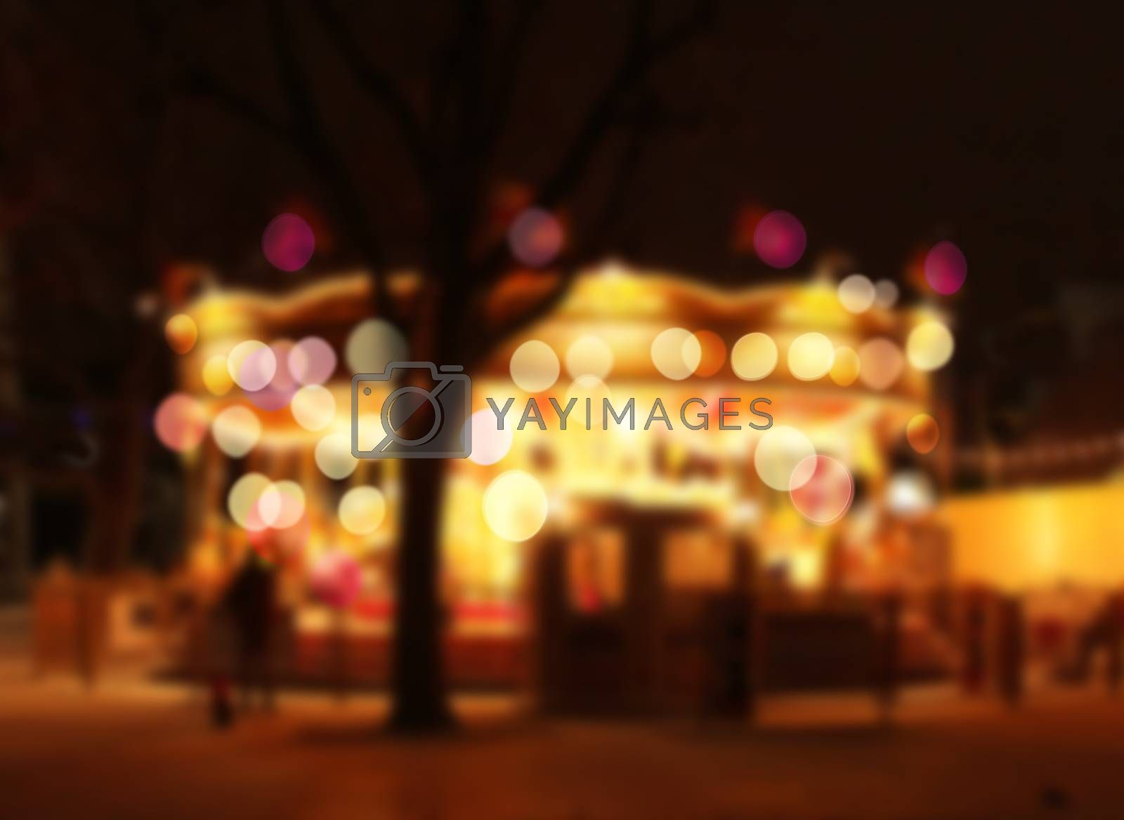 Royalty free image of Blurry carrousel lights bokeh by anterovium