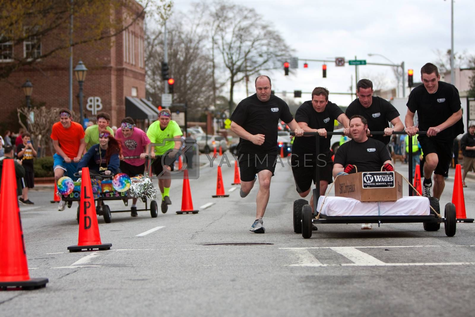 Royalty free image of Two Teams Race Beds On City Street by BluIz60