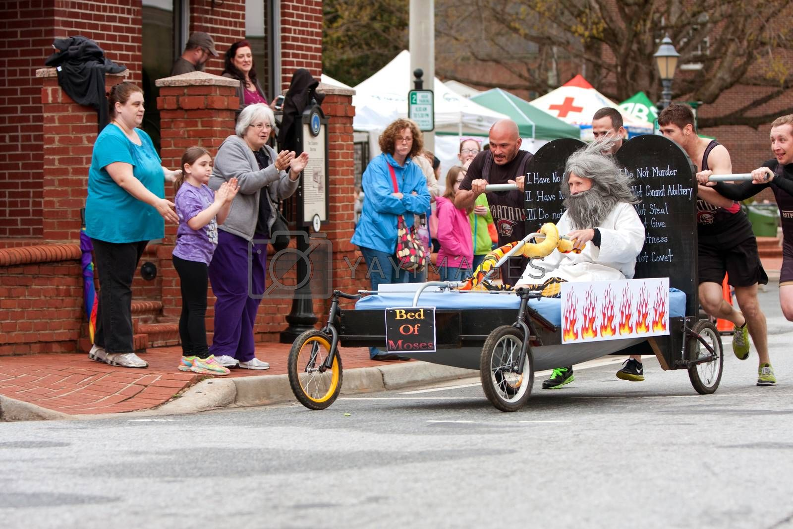 Royalty free image of Team Pushes Bed Of Moses In Annual Fundraiser Race  by BluIz60