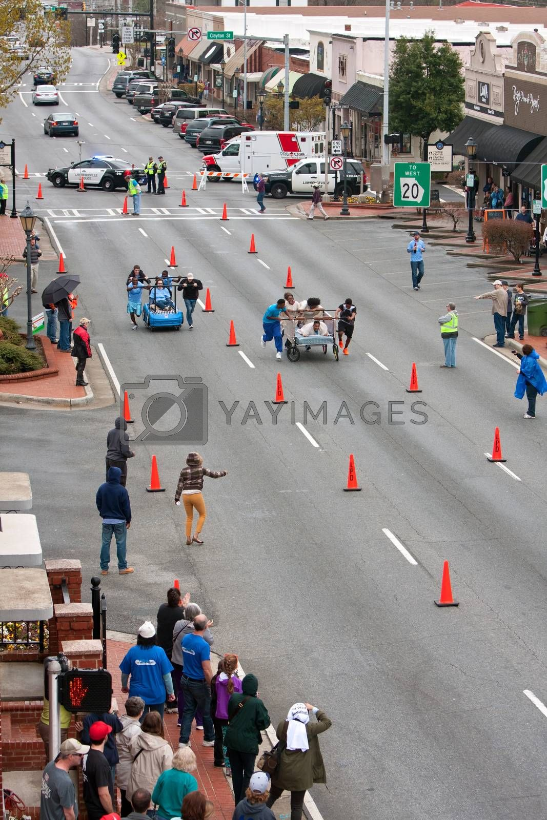 Royalty free image of Two Teams Race Beds On City Street In Fundraiser Event by BluIz60