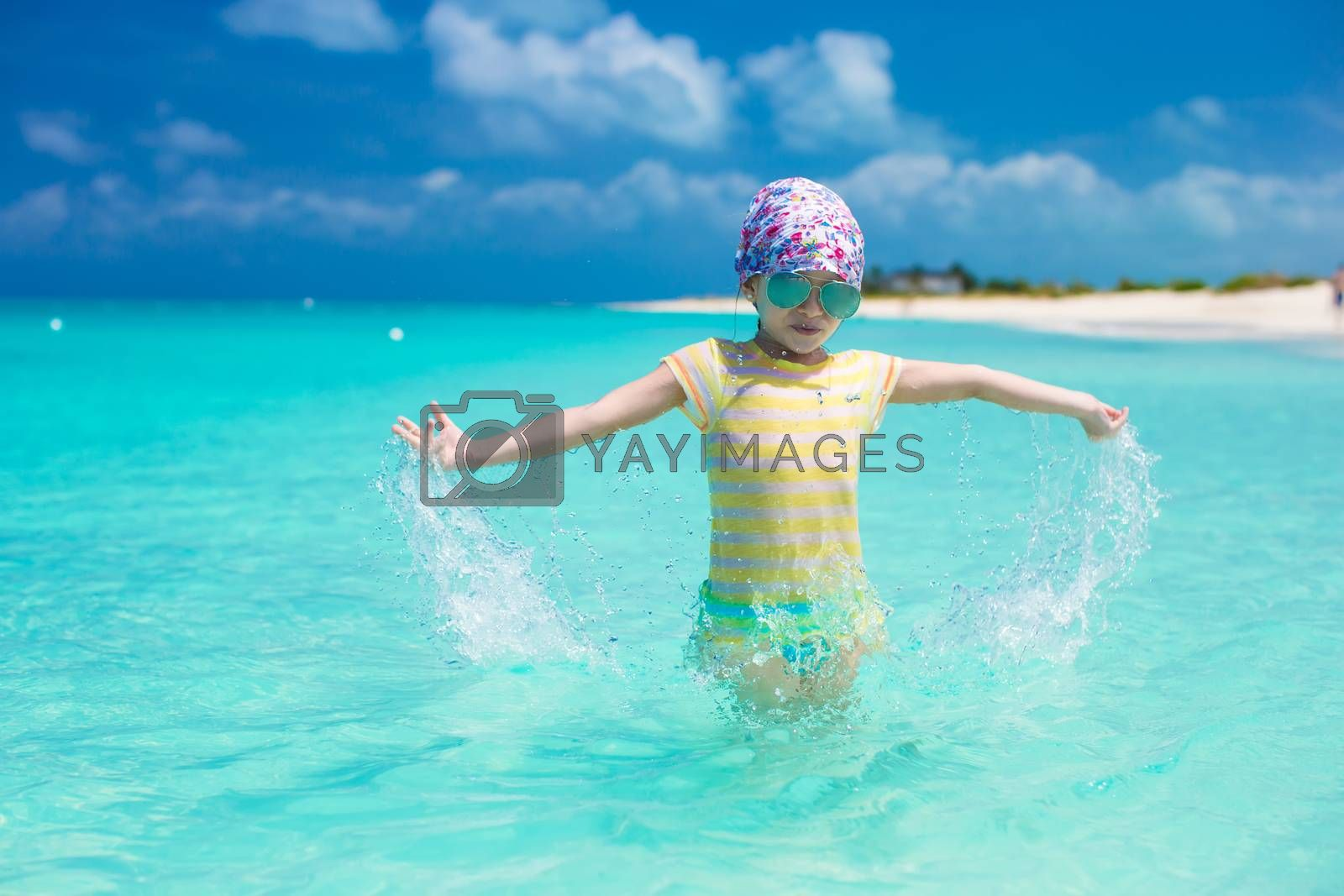 Royalty free image of Happy little girl have fun at beach during caribbean vacation by travnikovstudio