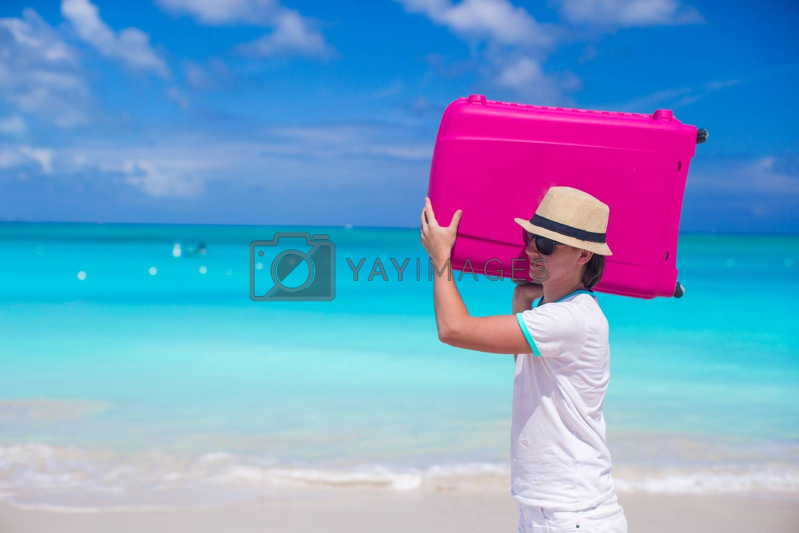 Royalty free image of Portrait of happy man carrying his luggage on summer vacation by travnikovstudio