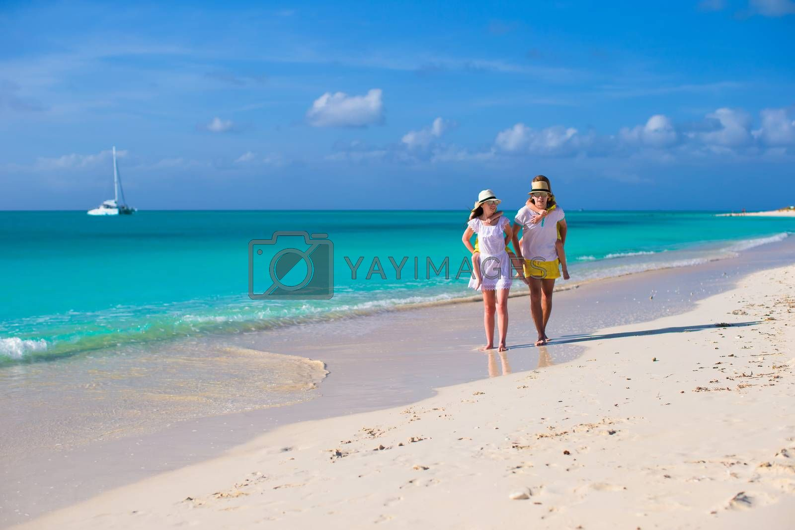 Royalty free image of Young happy couple have fun on carribean vacation by travnikovstudio