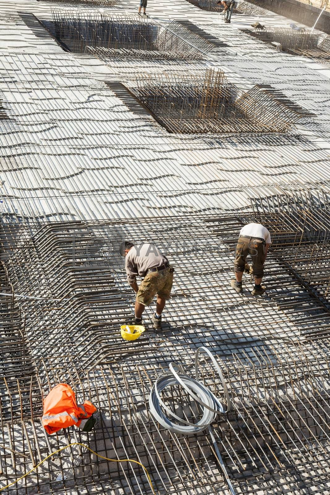 Royalty free image of workers do the steel bars construction  by meinzahn