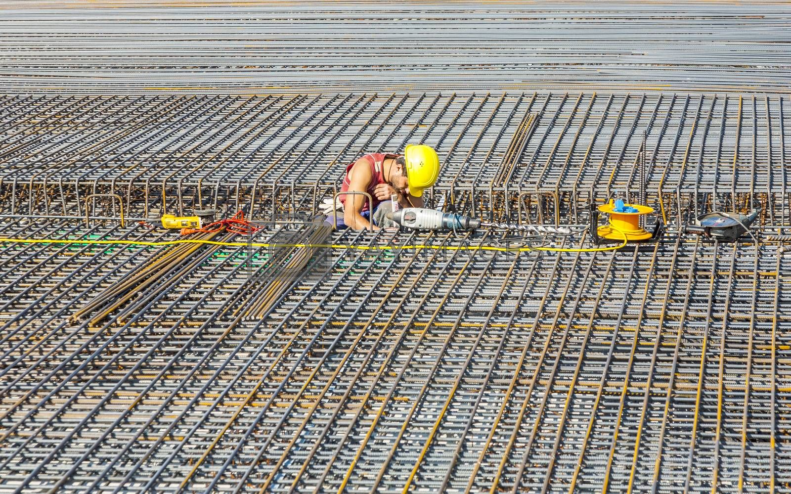 Royalty free image of workers do the steel bars construction at the building site  by meinzahn