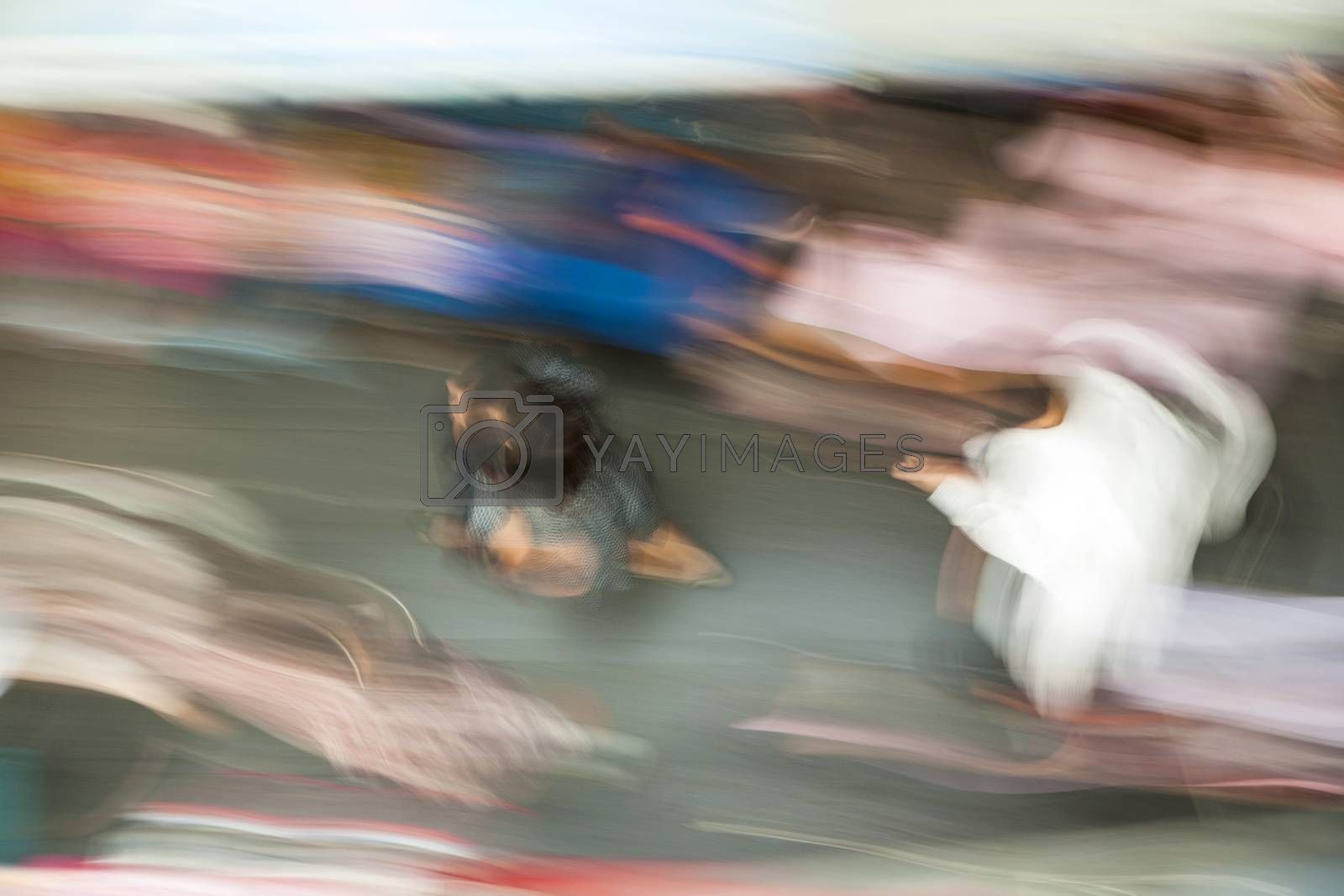 Royalty free image of people in motion at the sidewalk by meinzahn