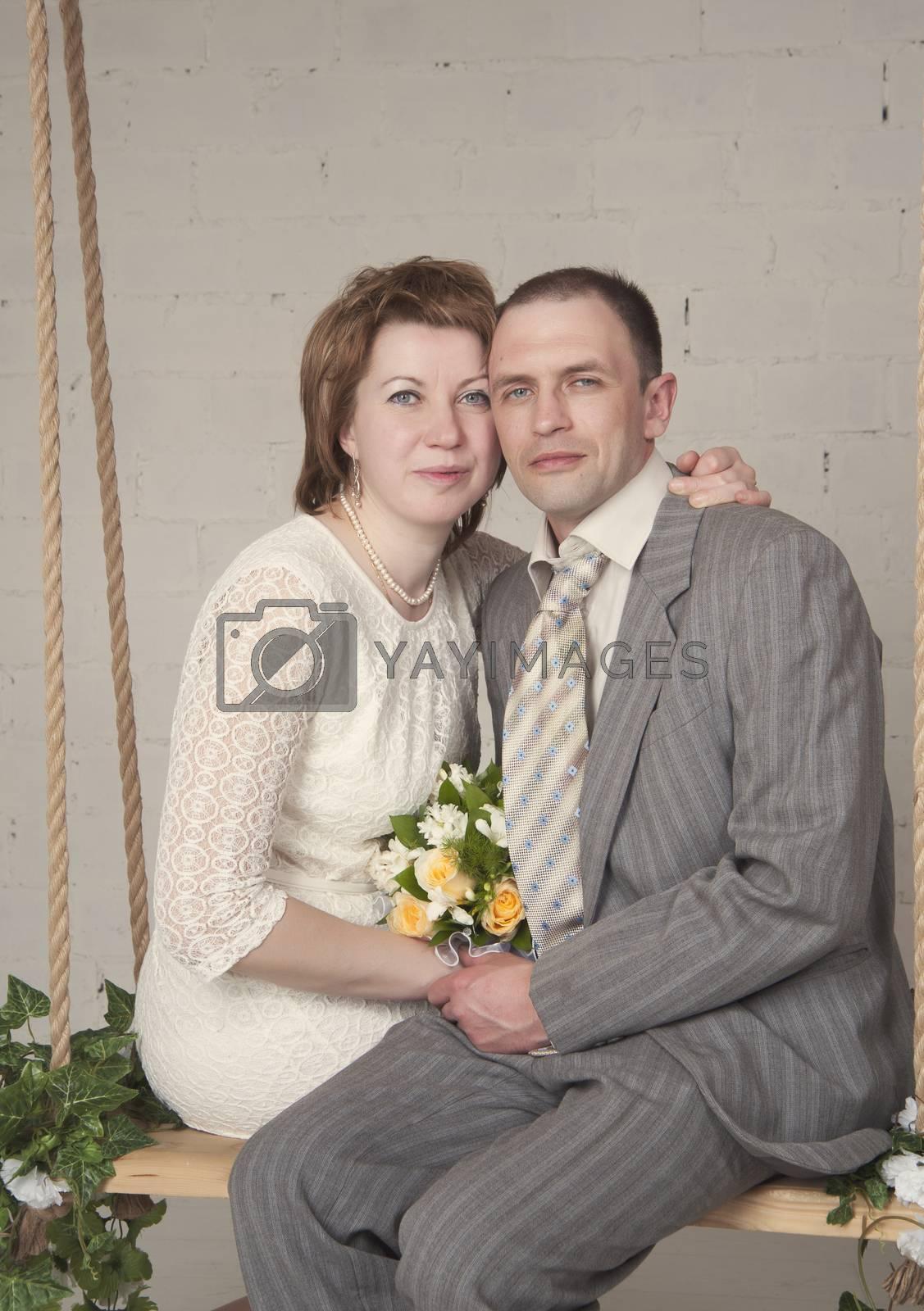 Royalty free image of bride and bridegroom by raduga21