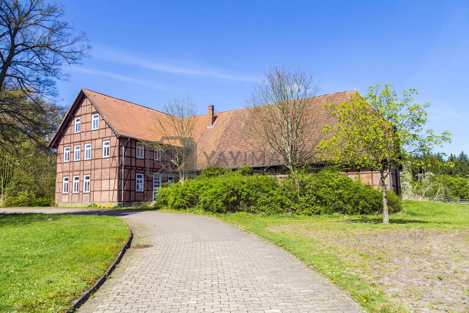 Royalty free image of old farm house in Osterheide by meinzahn
