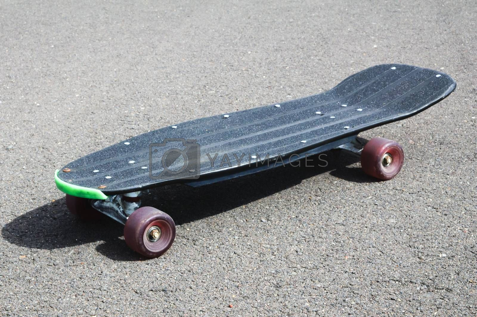 Royalty free image of Vintage Style Longboard Black Skateboard by underworld
