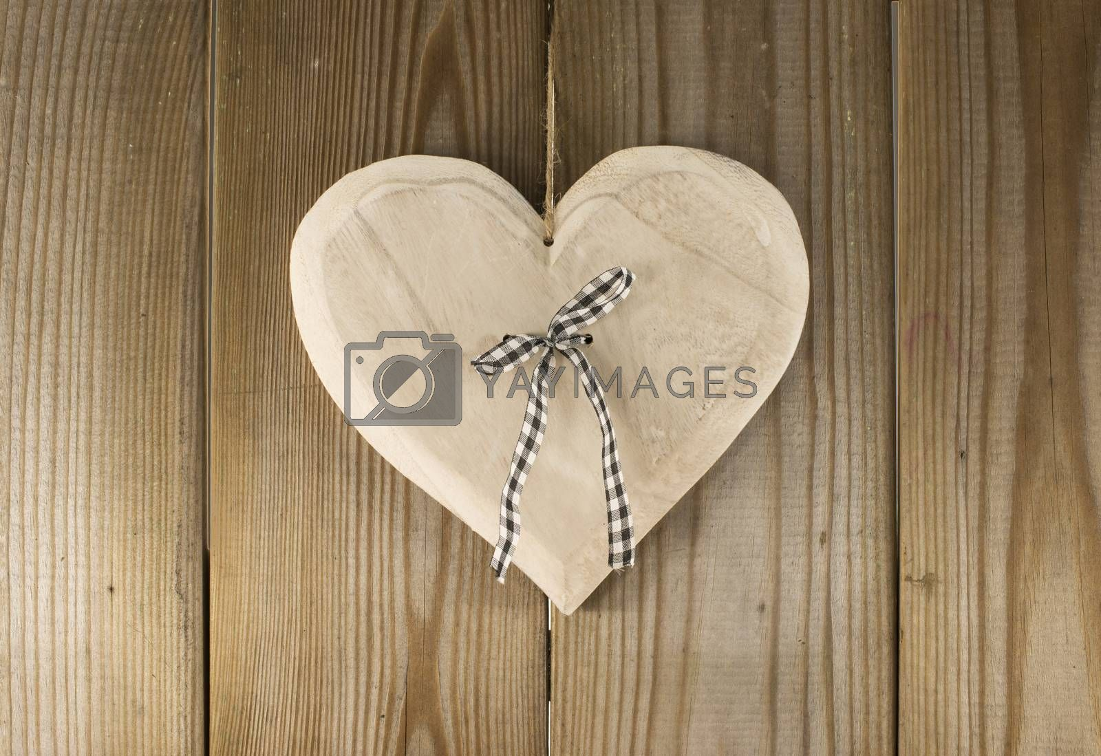 Royalty free image of hanging valentines heart by compuinfoto