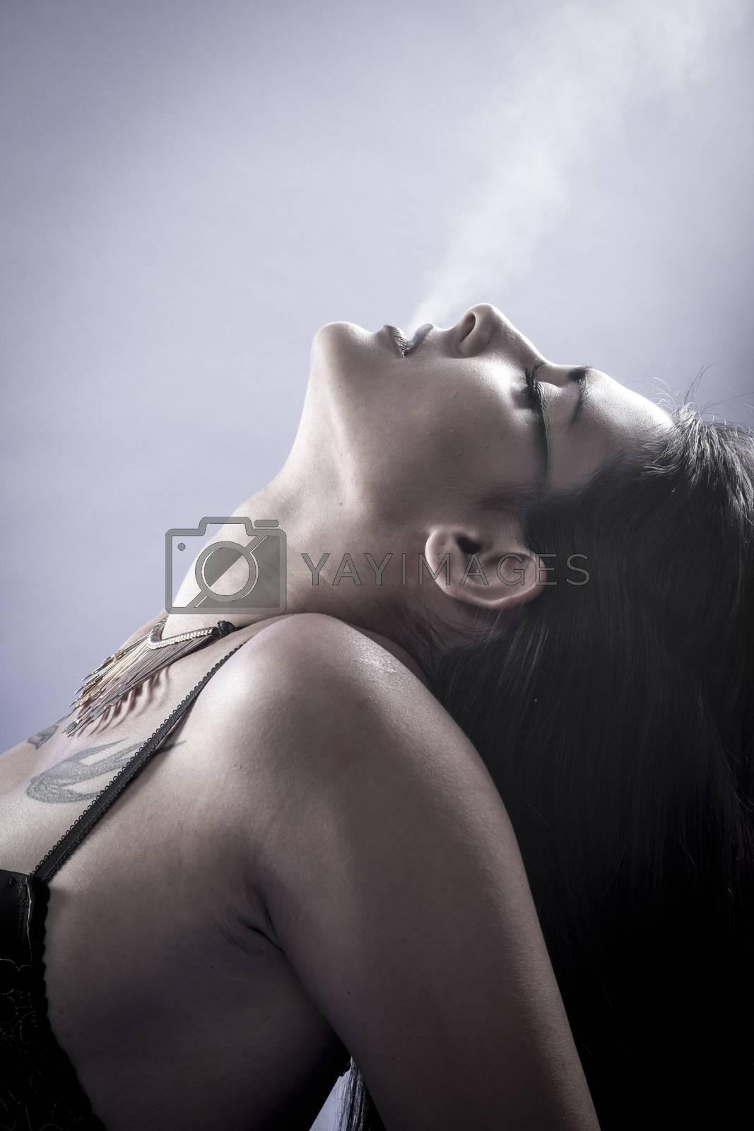 Royalty free image of glamour, Sensual brunette dressed in black lingerie by FernandoCortes