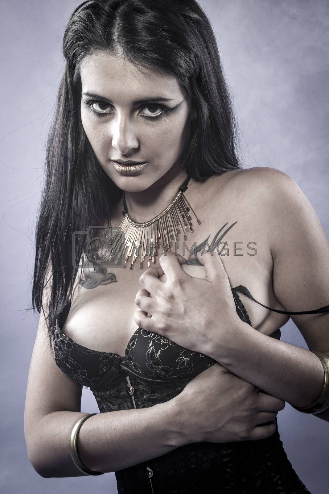 Royalty free image of Sensual brunette dressed in black lingerie, golden jewelry by FernandoCortes
