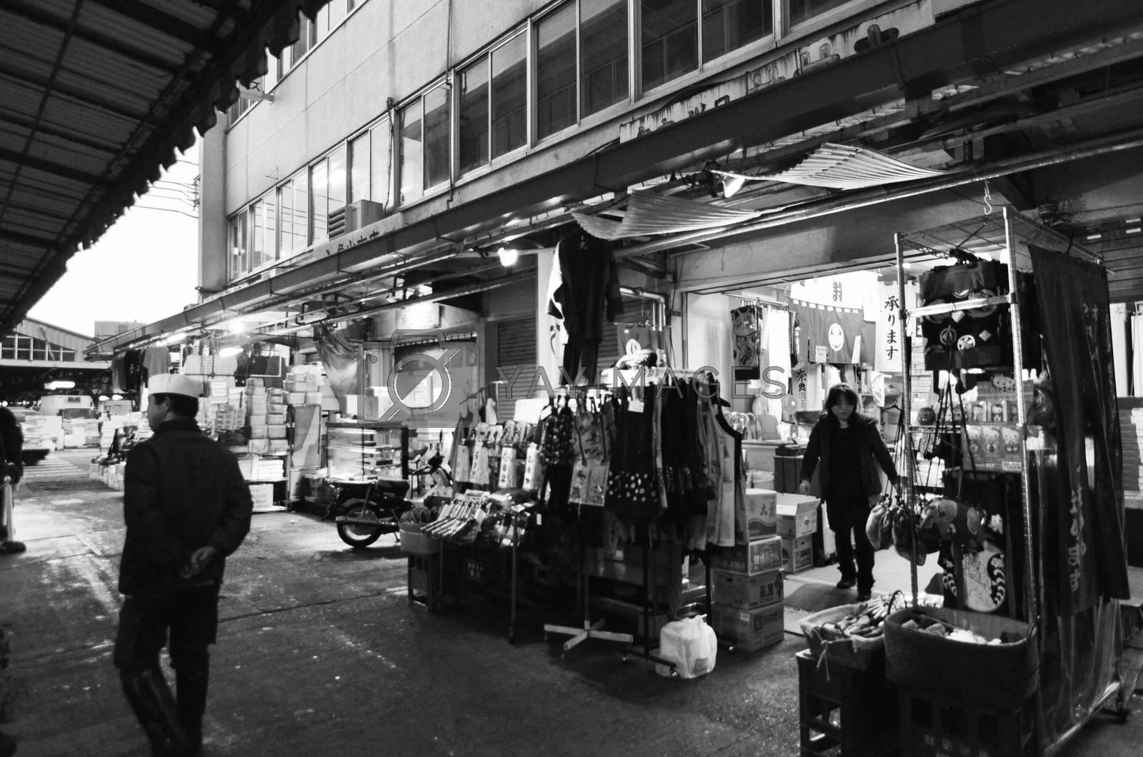 TOKYO, JAPAN- NOV 26, 2013: Tsukiji market is a large market for fish in central Tokyo. The market consists of small shops and restaurants crowded along narrow lanes. Tokyo, Japan. November 26 2013