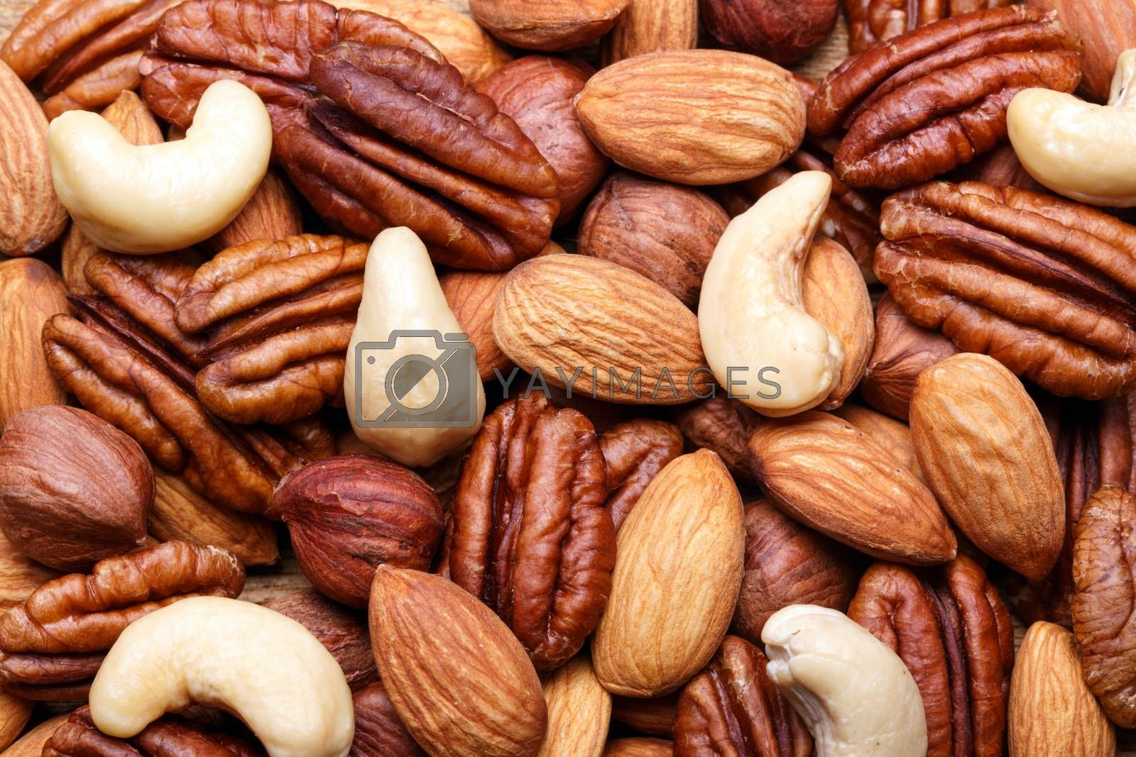 Royalty free image of Background texture of assorted mixed nuts including cashew, peca by primopiano