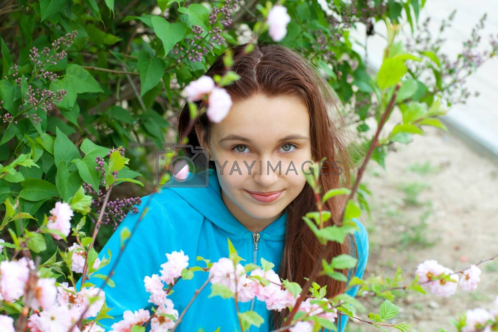 portrait of a girl in spring flowers
