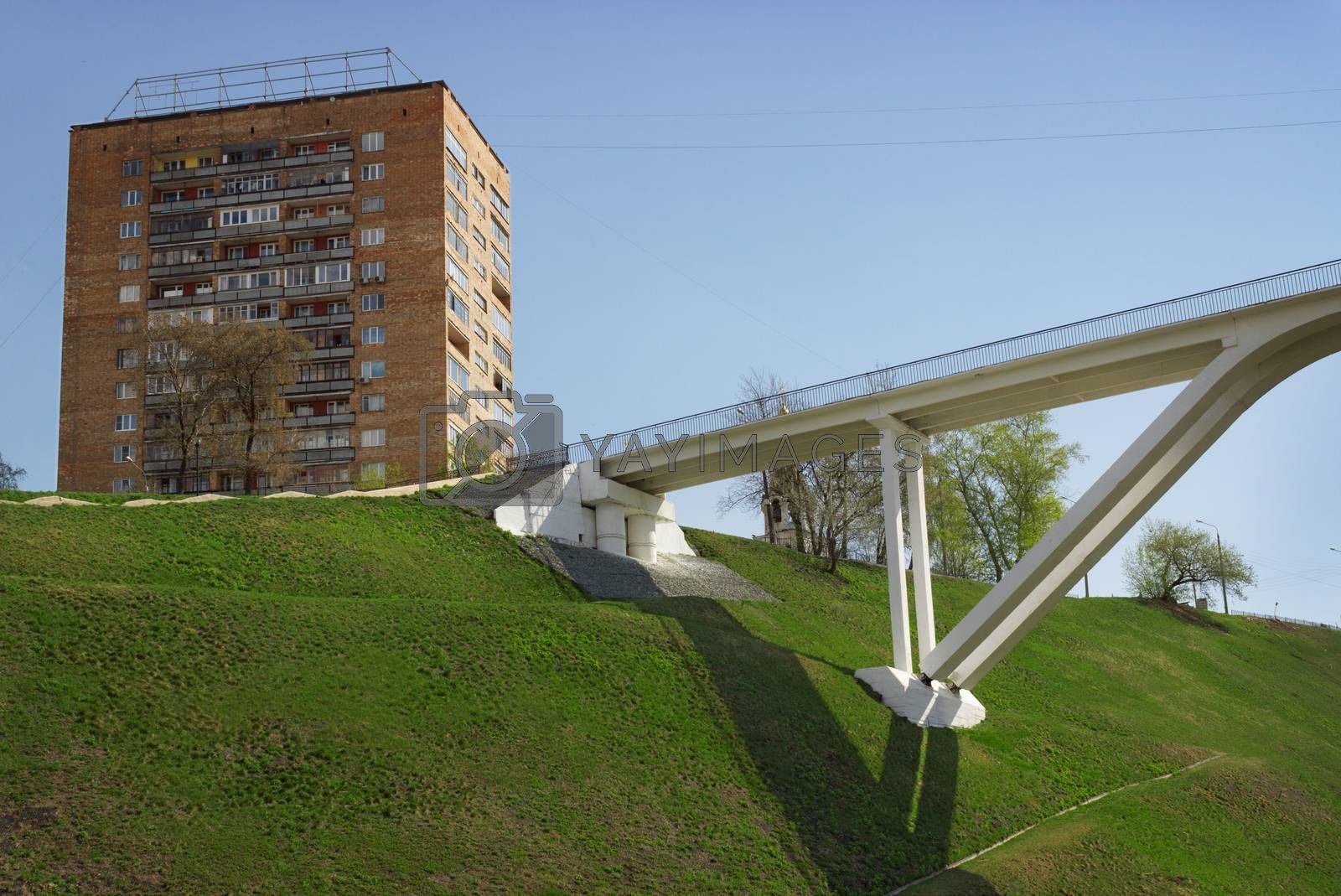 Royalty free image of Pedestrian bridge of concrete across the ravine by sever180