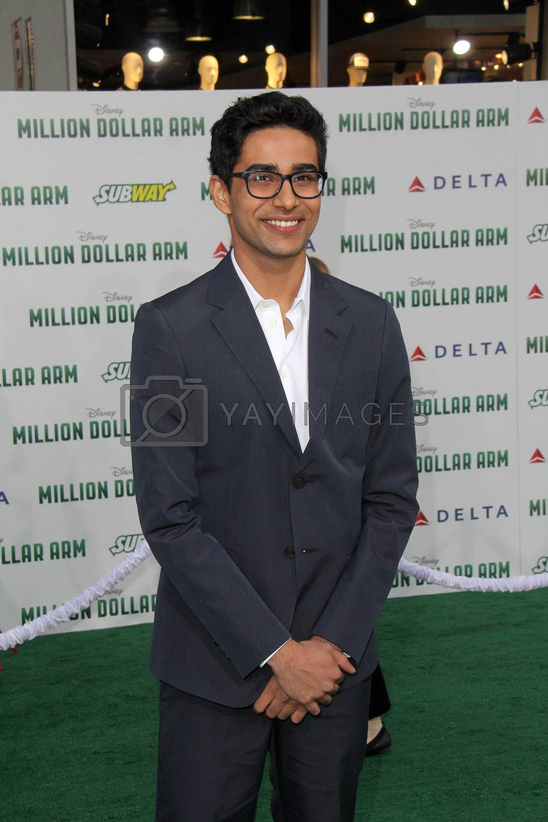 """Royalty free image of Suraj Sharma at the """"Million Dollar Arm"""" World Premiere, El Capitan, Hollywood, CA 05-06-14/ImageCollect by ImageCollect"""