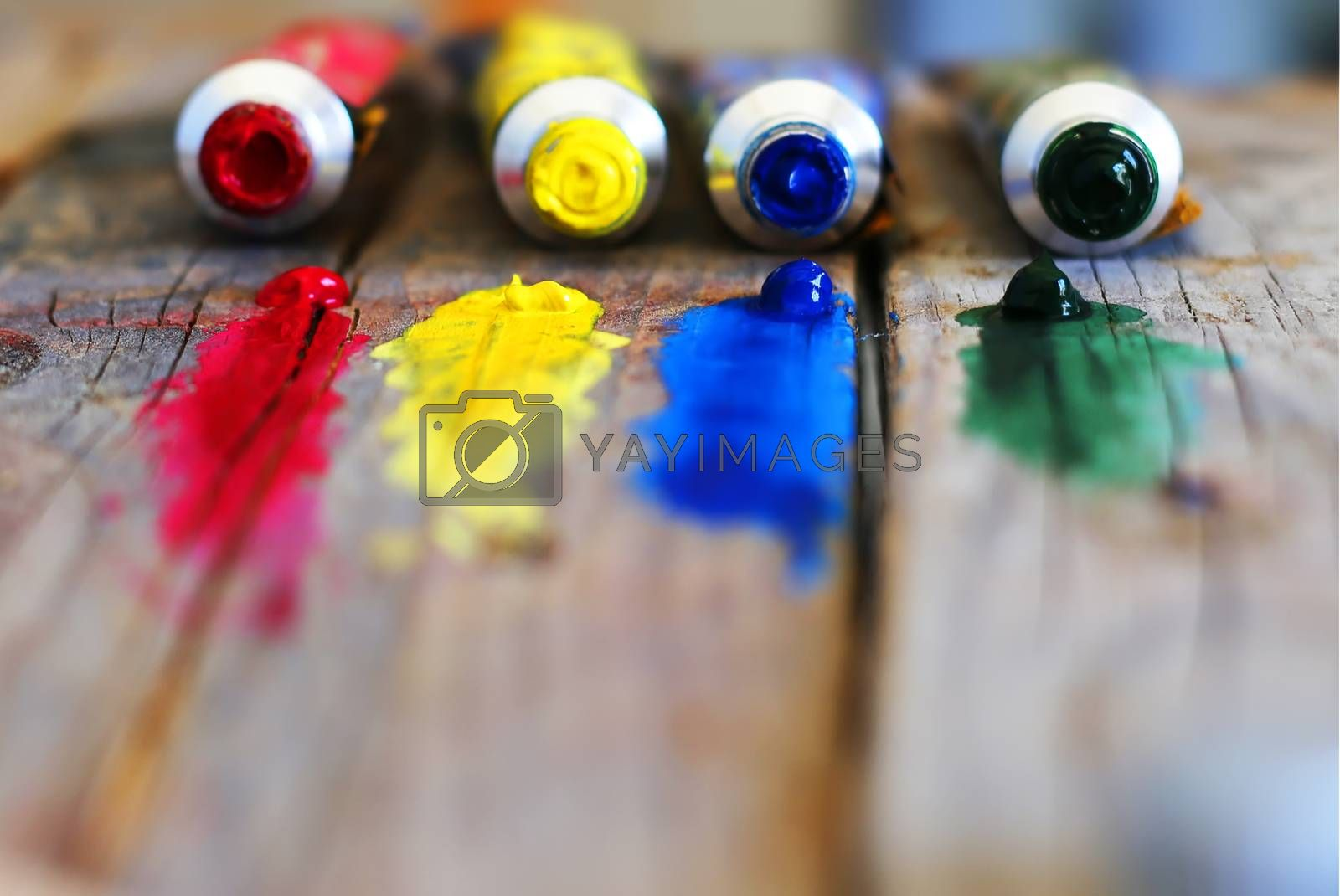 Photo of  4 paint tubes: red, yellow, blue and green
