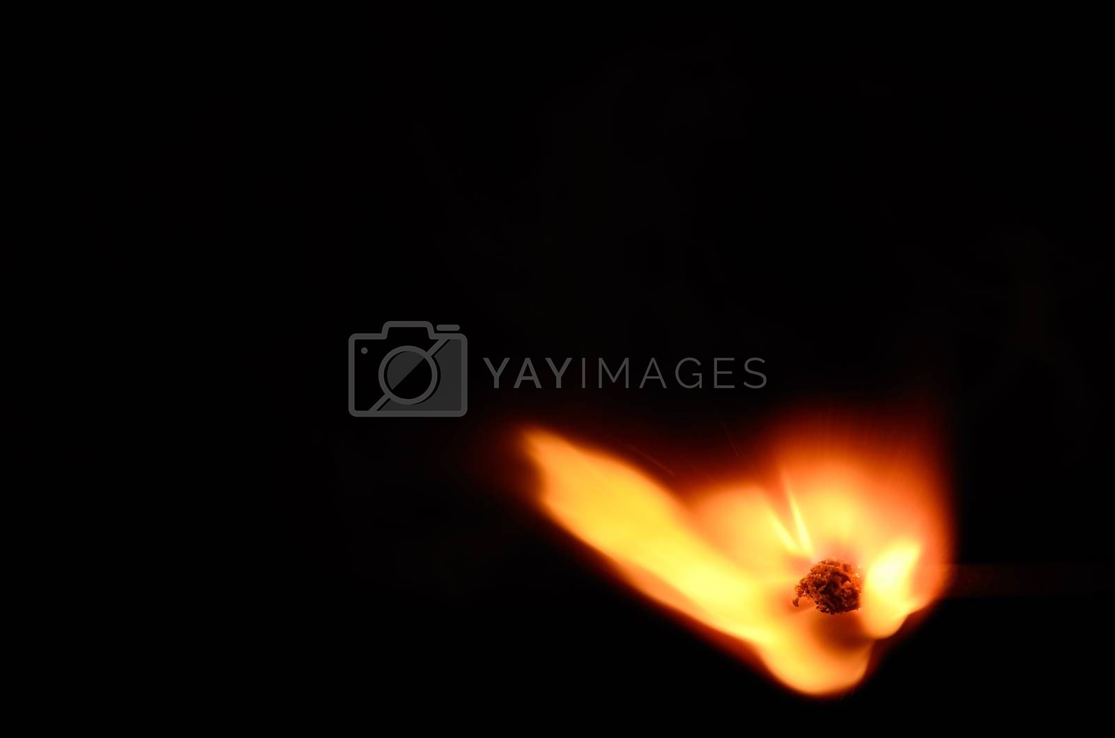 ignited match with hot flame on black background