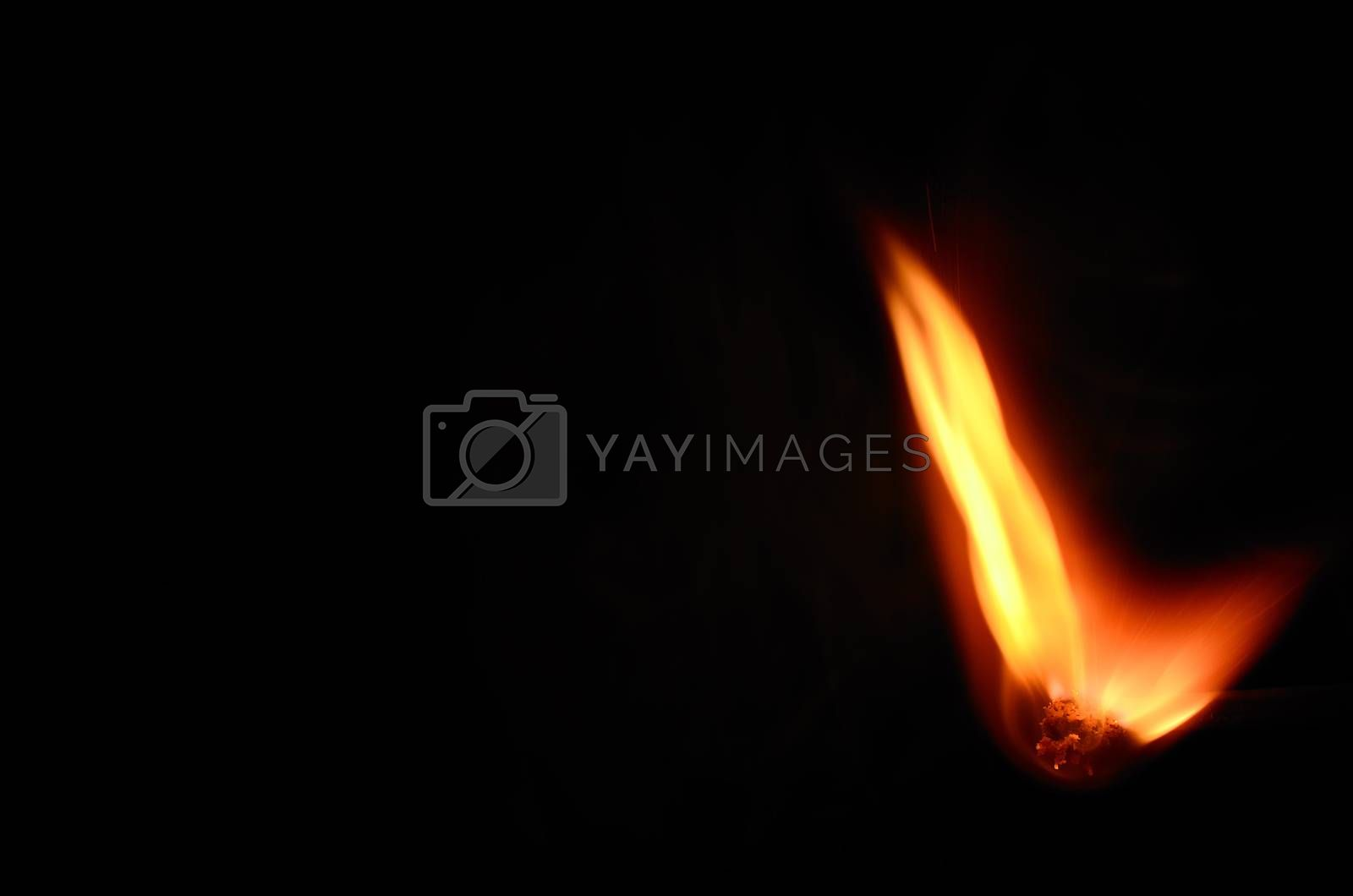 match with hot bright flame on black background