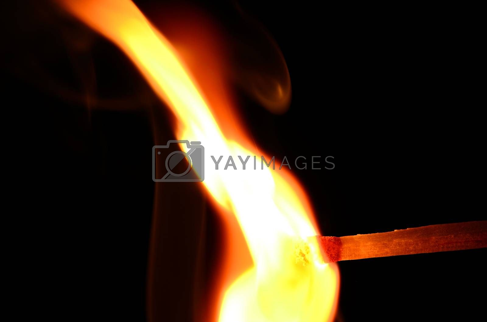 match with a large hot flame on black background
