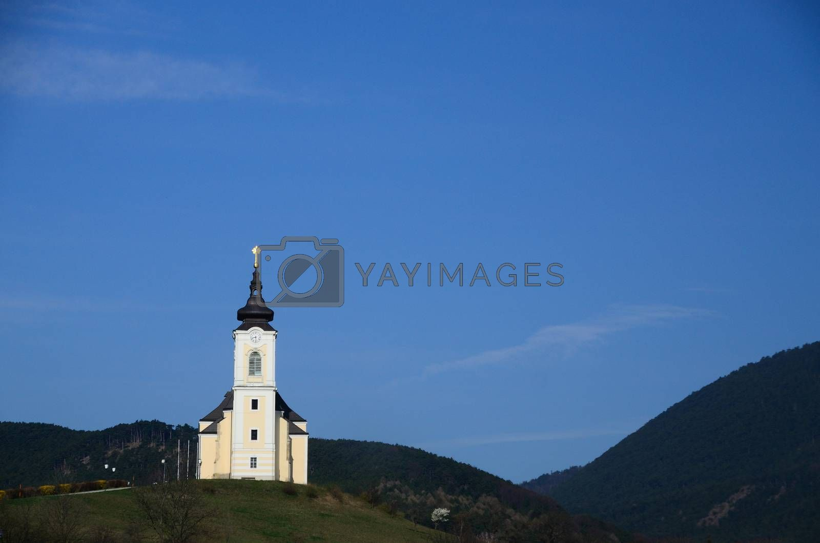 white church in mountains with blue sky