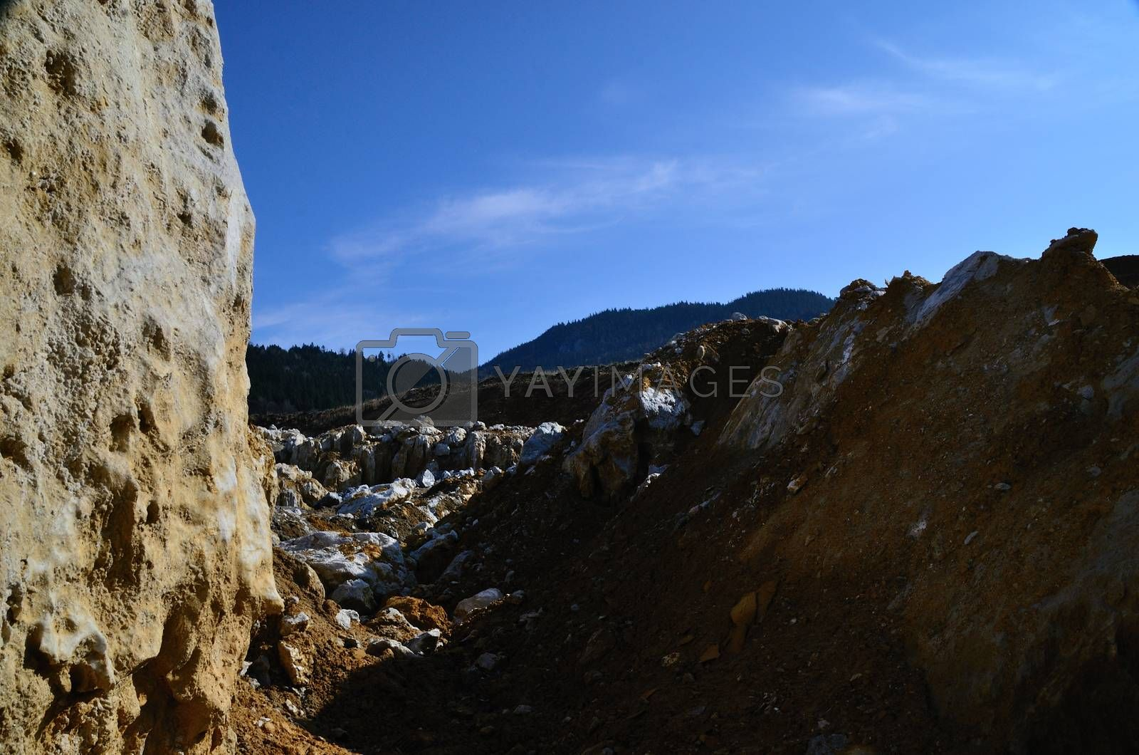 large quarry in the mountains with blue sky