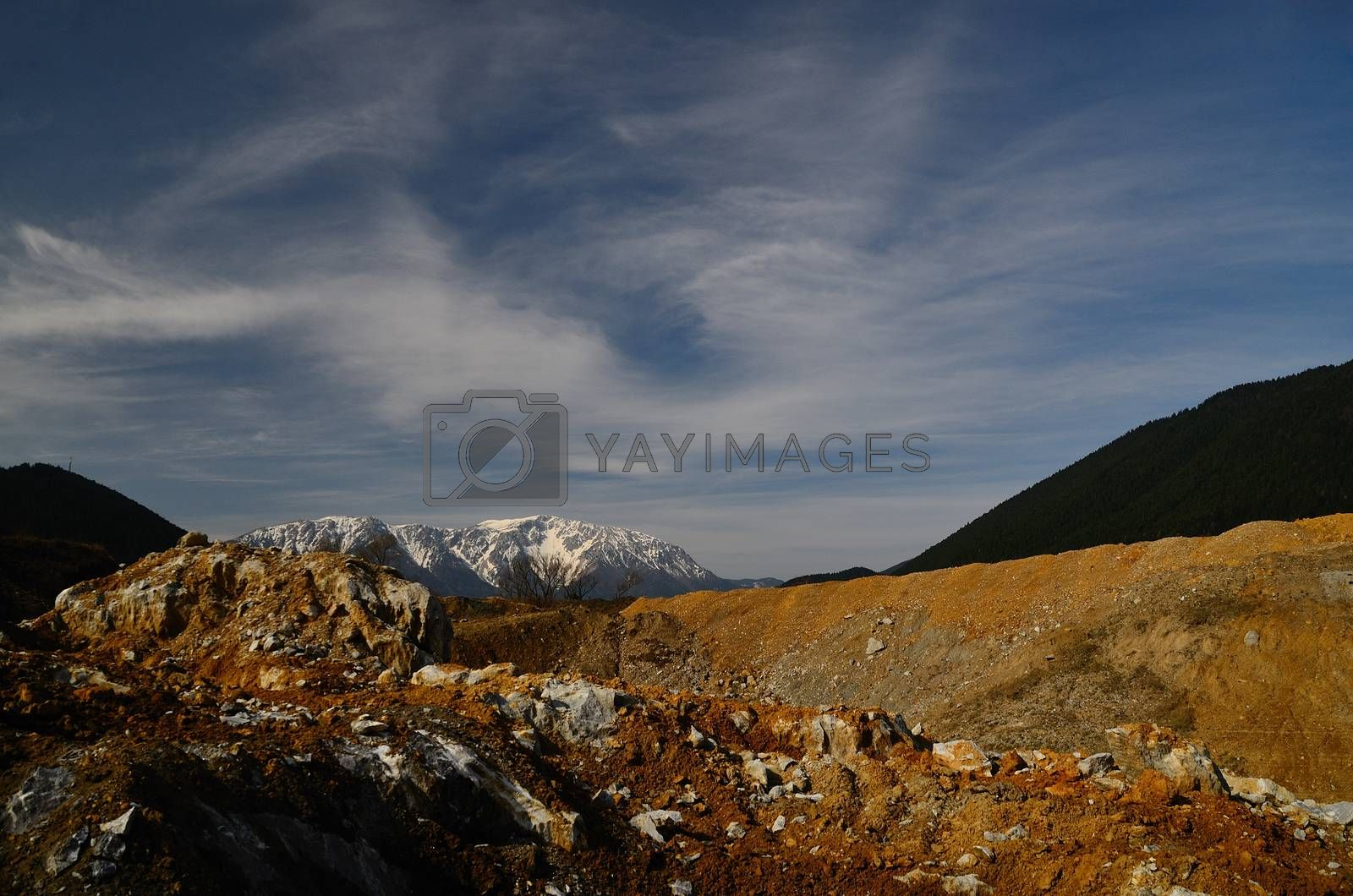 quarry with beautiful sky and snowy mountain in the background