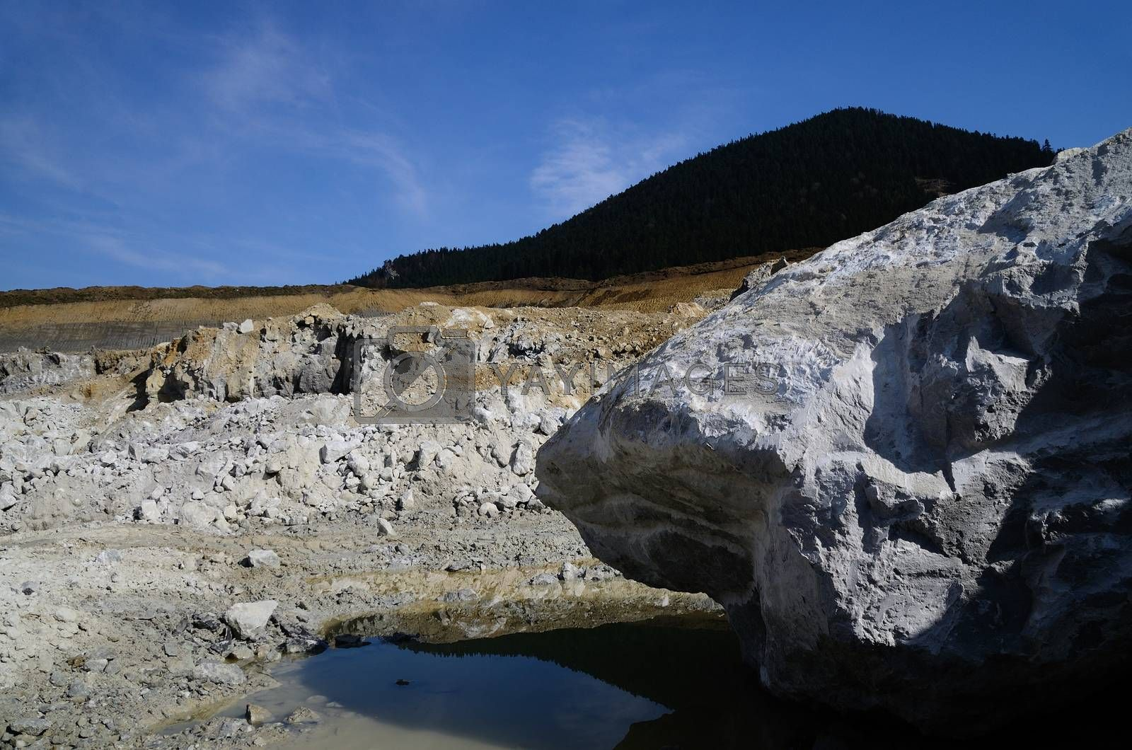 large quarry with water and reflection
