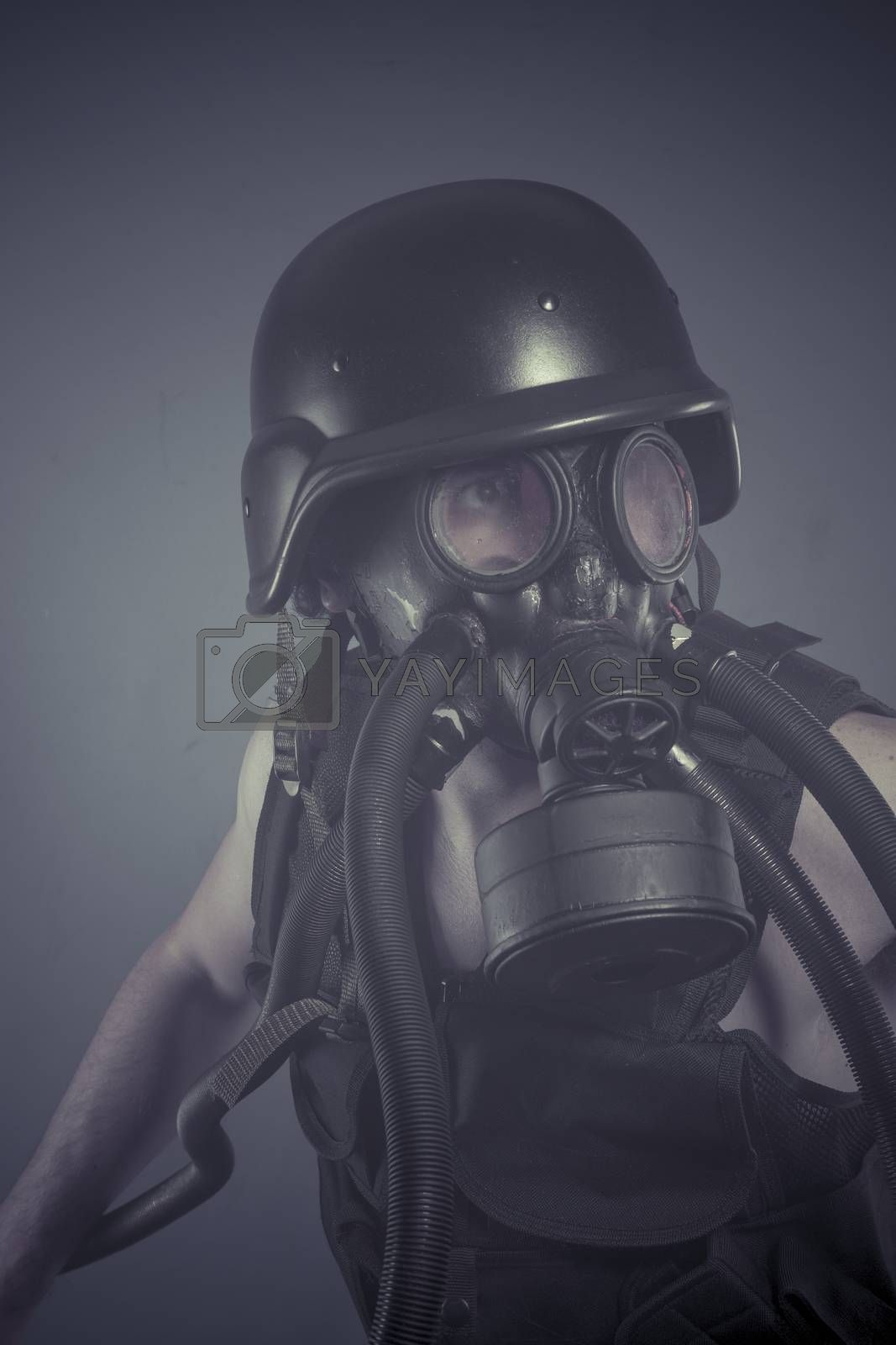 Survival, Man with black gas mask, pollution concept and ecological disaster