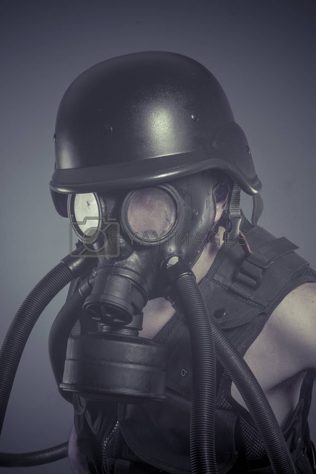 Inhalation, Man with black gas mask, pollution concept and ecolo by FernandoCortes