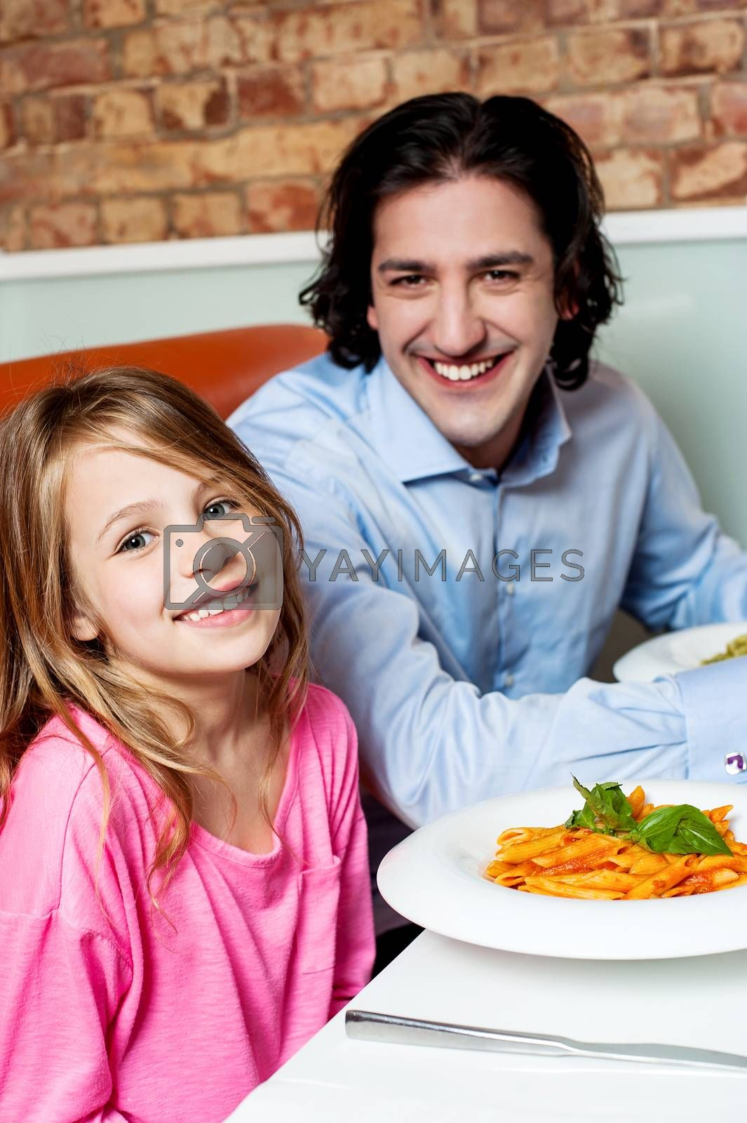 Father dining with his cute little daughter