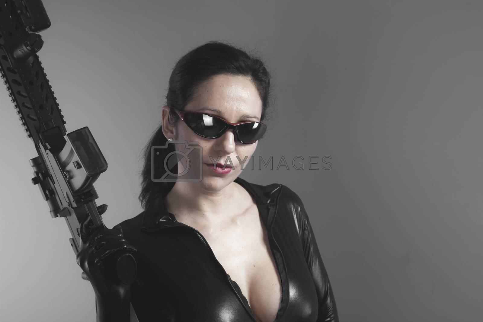 Brunette woman with enormous bulletproof vest and gun by FernandoCortes