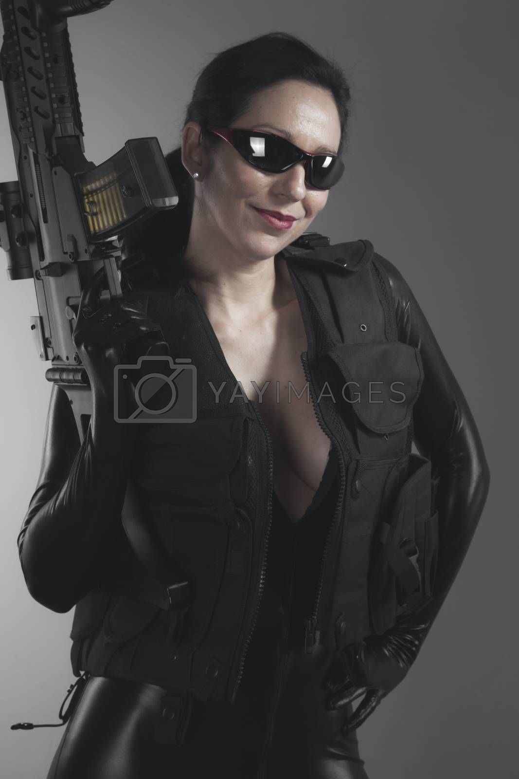 Costume, Brunette woman with enormous bulletproof vest and gun by FernandoCortes