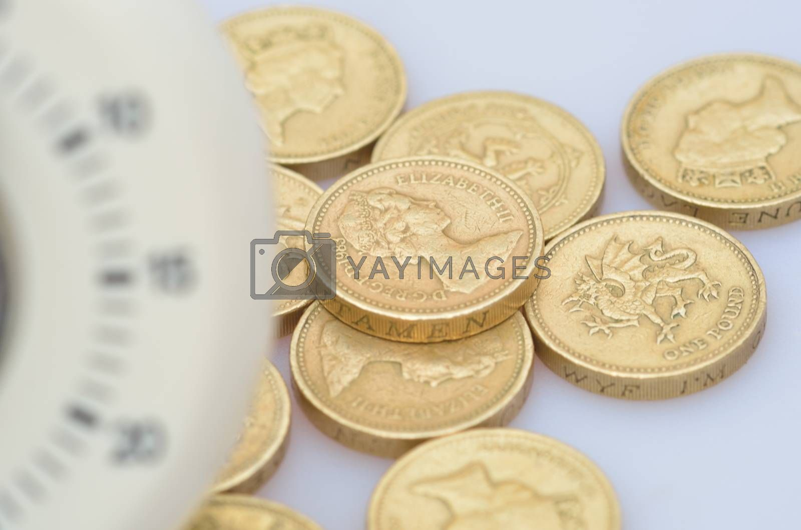 blurred timer and coins by pauws99