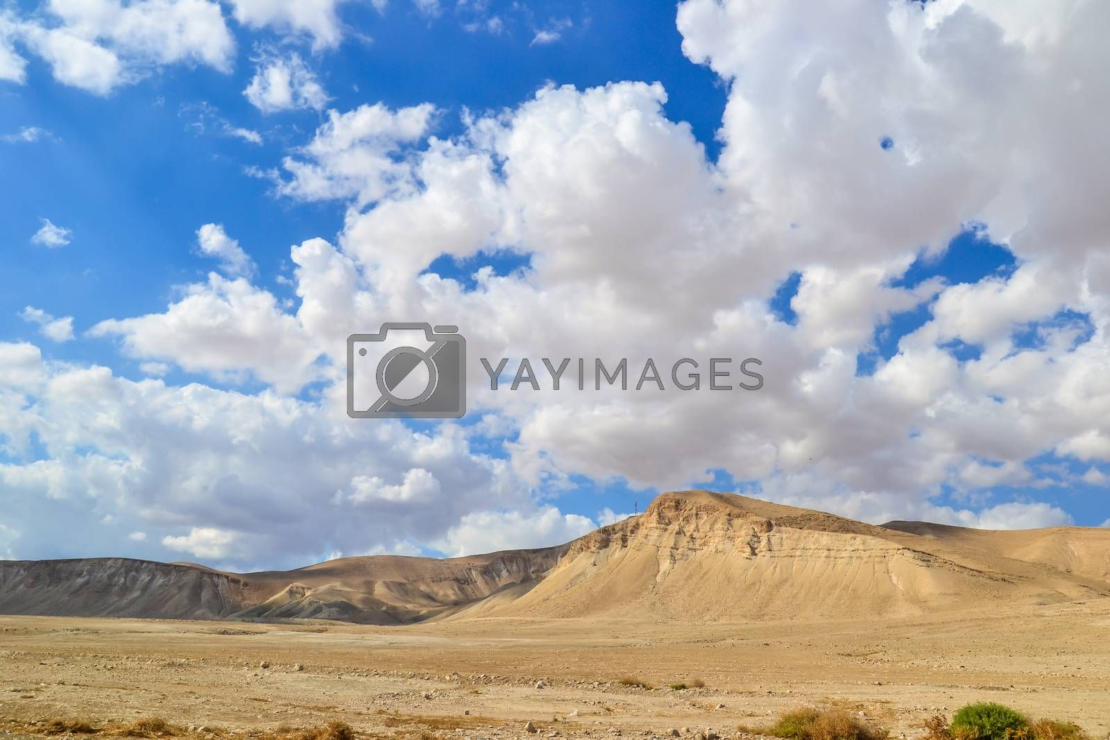 Desert mountain with the cloudy sky