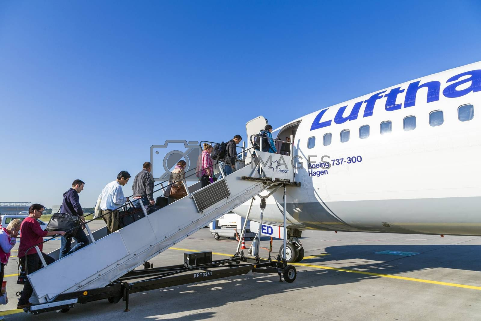 FRANKFURT, GERMANY - MAY 4: people board the Lufthansa aircraft on May 4, 2014 in Frankfurt, Germany. Frankfurt is  the busiest airport in Germany and one of the mosy busy in Europe.