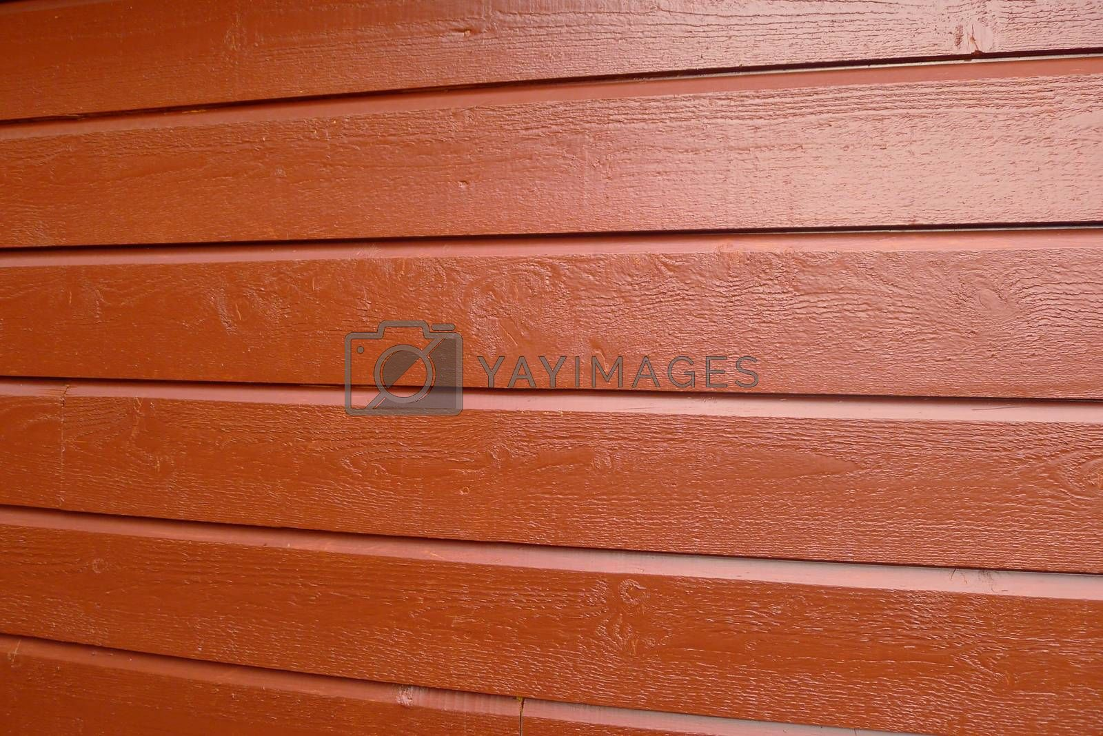 Red painted wooden house wall