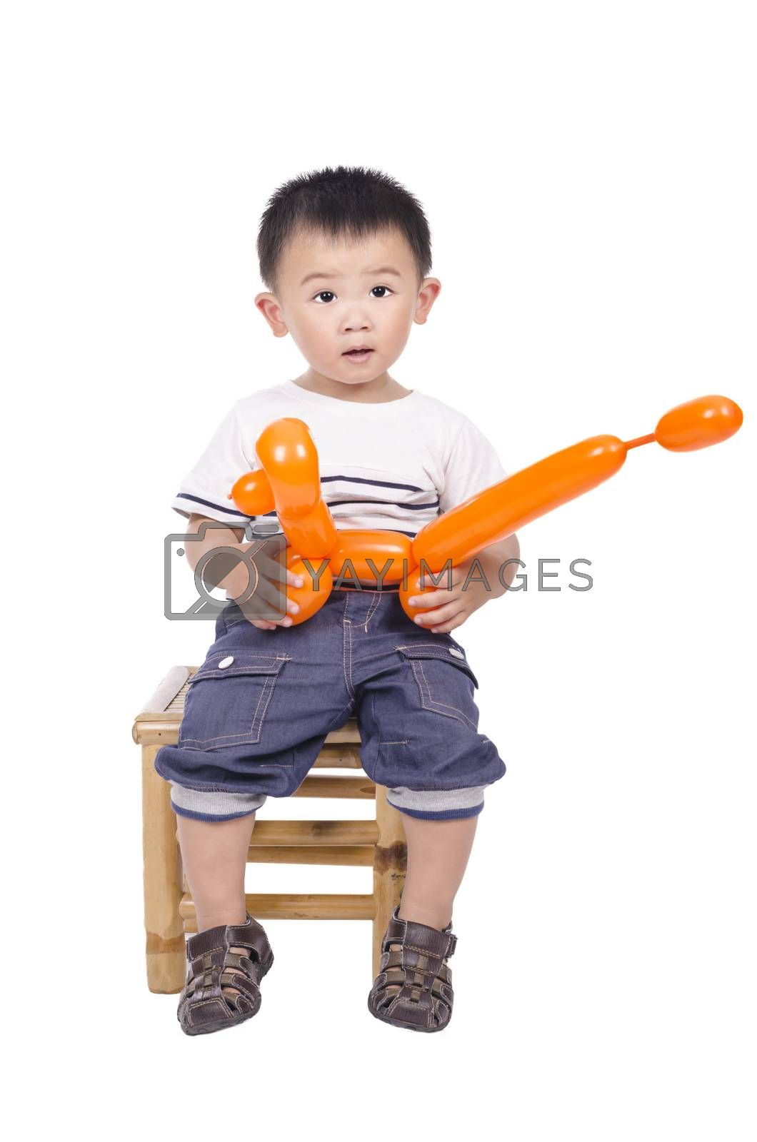 Royalty free image of Smart boy with balloon in his hand  by FrankyLiu