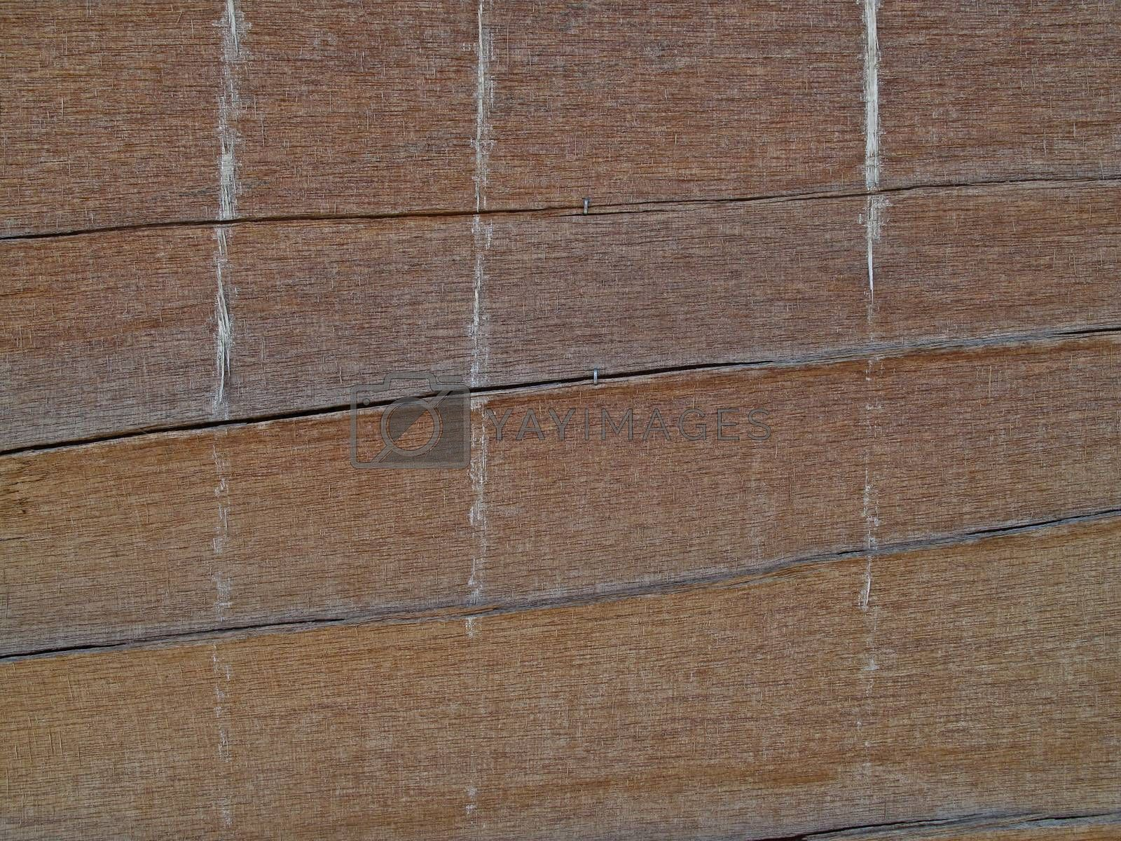 Royalty free image of drifted wooden background by RedDaxLuma